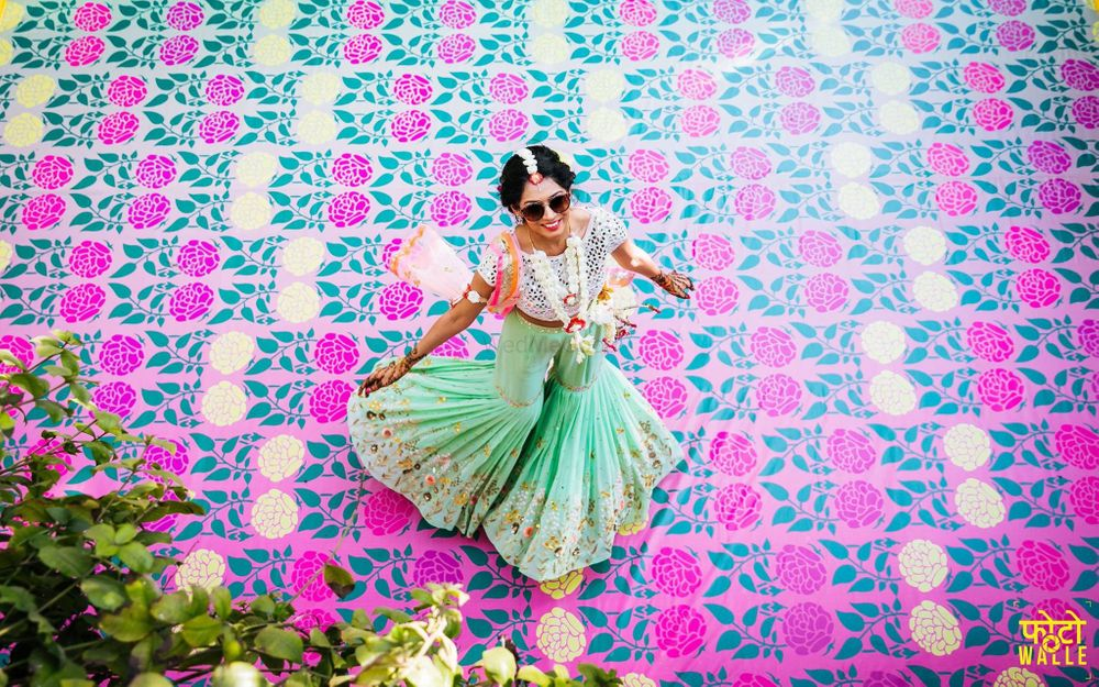 Photo of Mehendi decor idea with floral printed dance floor