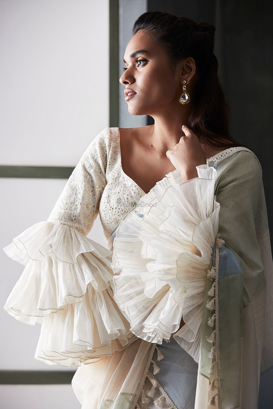 Photo of Unique frill blouse with saree in white