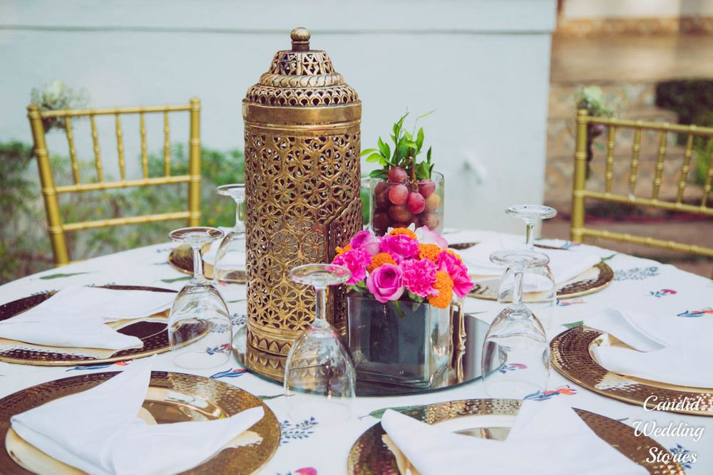 Photo of Table centrepiece with lamp and mirror