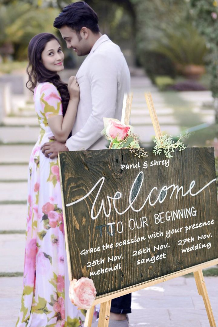 Photo of Couple pre wedding shot with invite board!