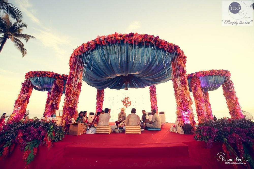 Photo of aqua and cherry mandap