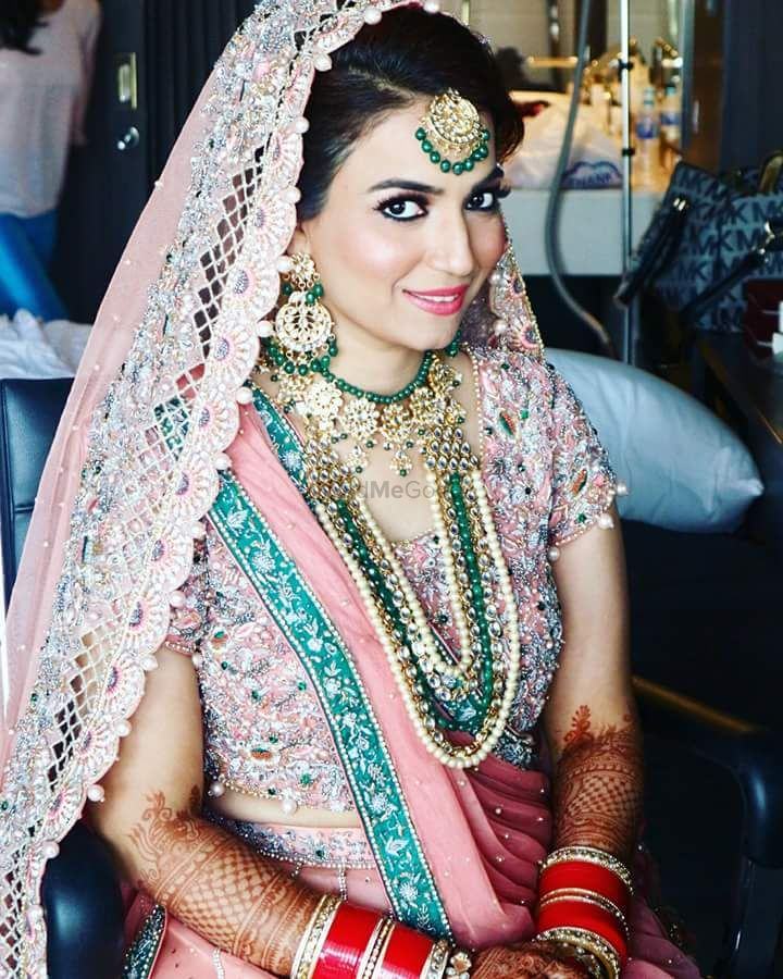 Photo of Bridal jewellery with a hint of green