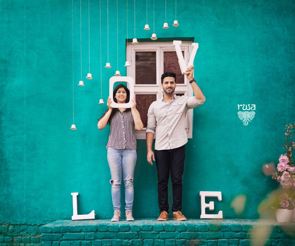 Photo of Pre wedding shoot with love prop