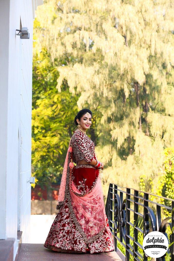 Photo of Maroon bridal lehenga in velvet with pink dupatta