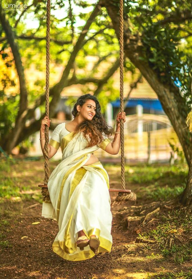 Photo of Post wedding shot of bride on swing