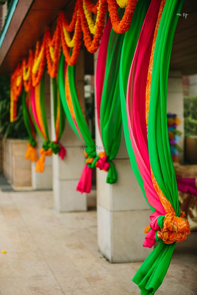 Photo of Colourful drapes in decor with flowers