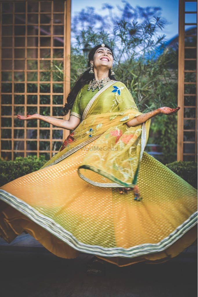 Photo of Happy bride wearing a yellow lehenga