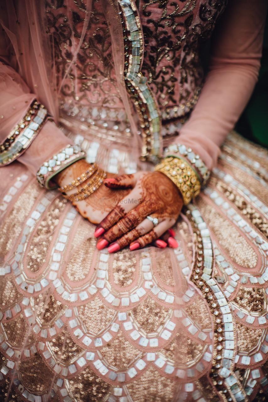 Photo of Bridal close up shot with mirror work lehenga