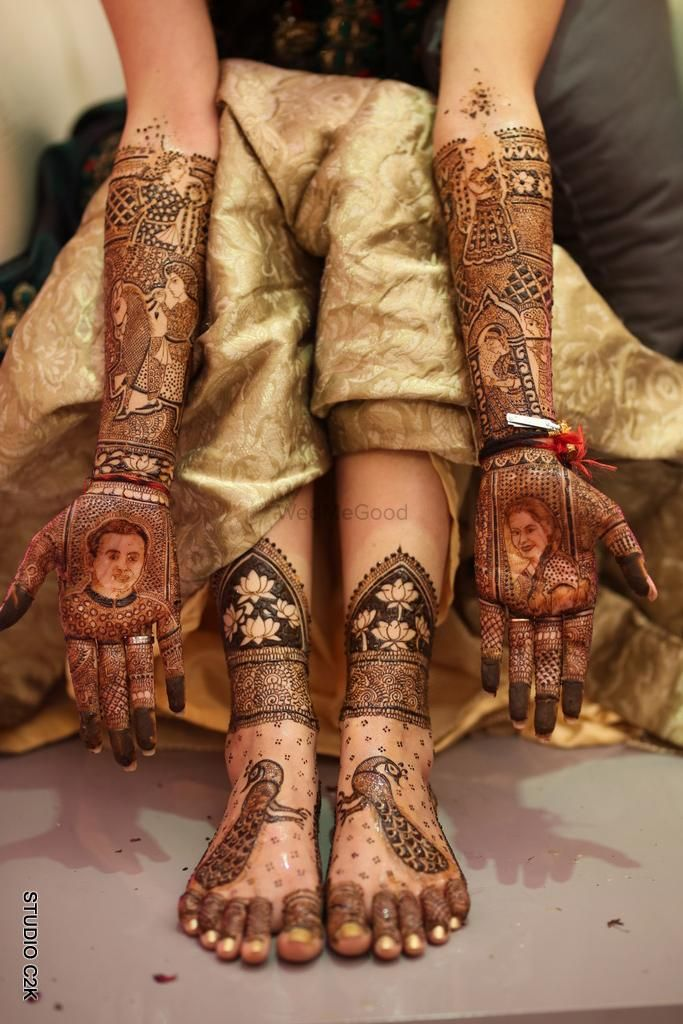 Photo of Hand mehendi with portraits and feet with peacock motifs