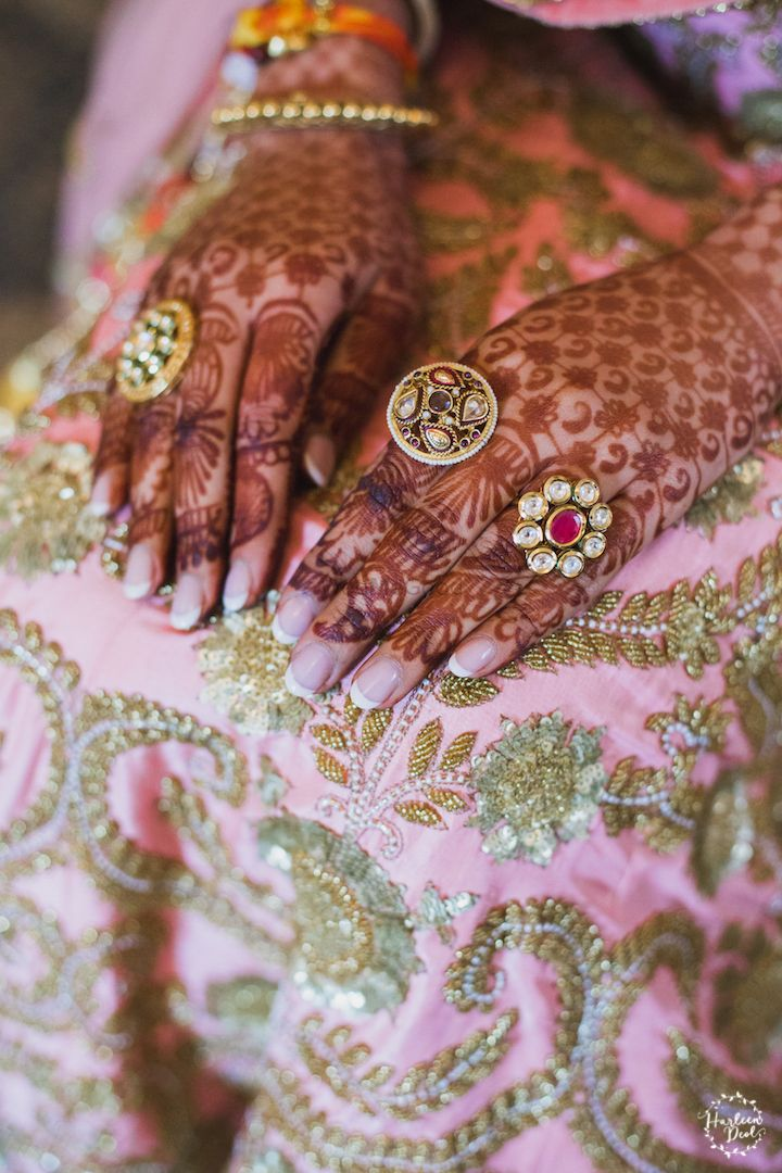 Photo of Bridal hands with rings and mehendi