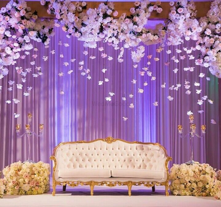Photo of Elegant stage backdrop with hanging floral strings in white