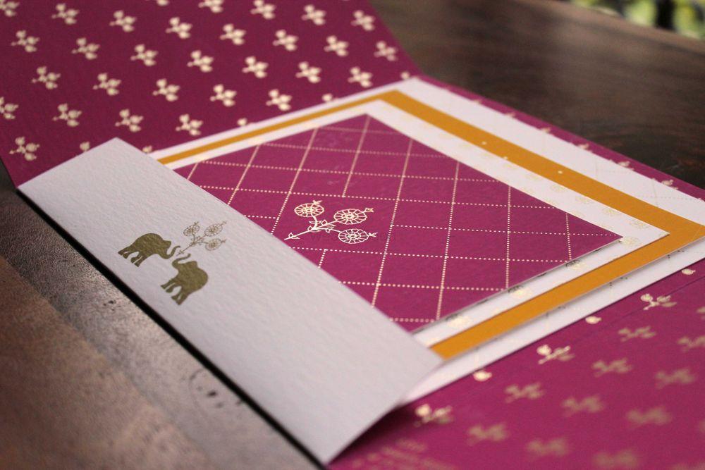 Photo of purple wedding cards