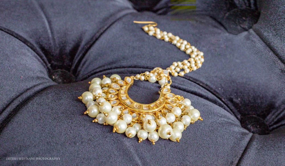 Photo of Gold and pearl jhoomer for bride