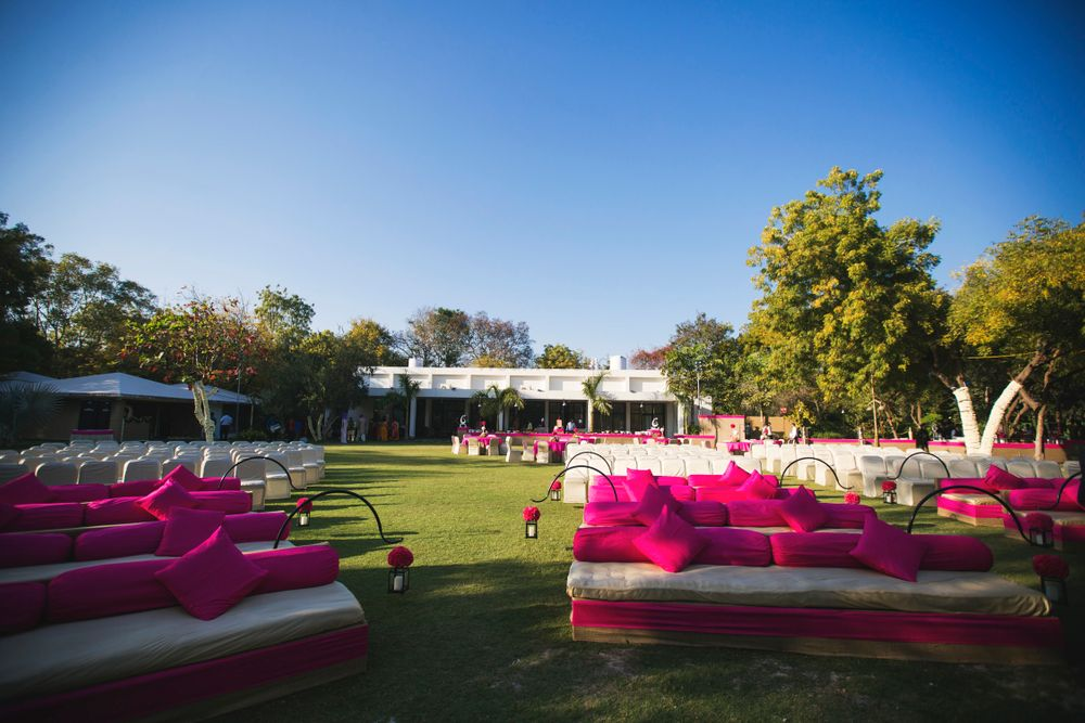 Photo of white and pink sofas with bright pink cushions