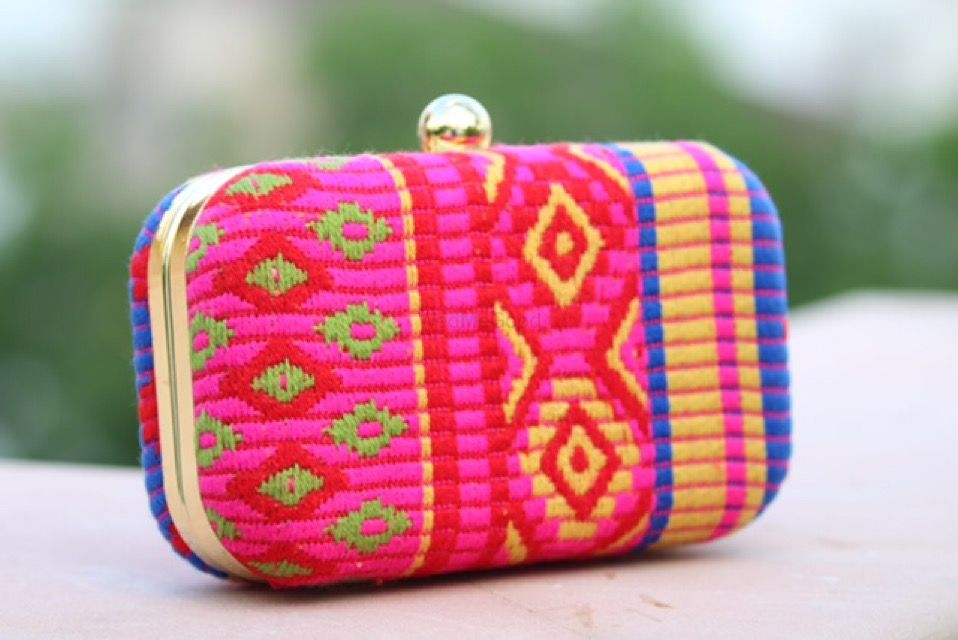 Photo of bright pink clutch