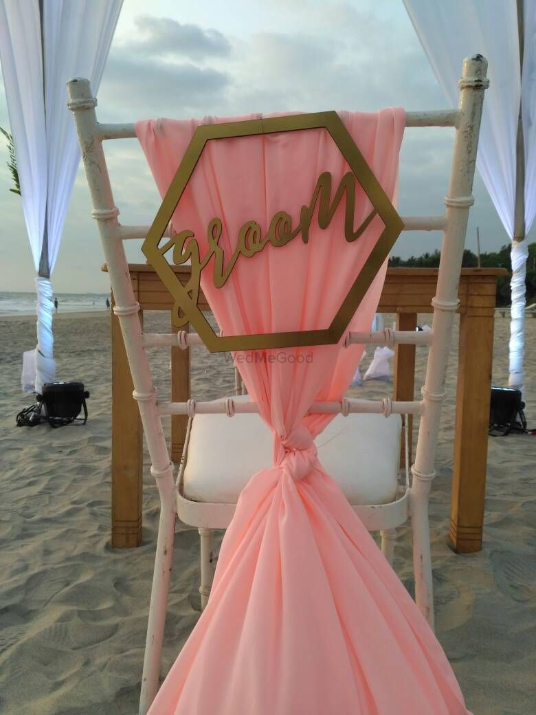 Photo of Chair decor idea with groom written on back