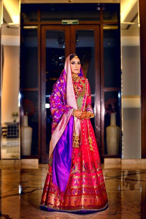 Photo of Gorgeous banarasi bridal lehenga in pink and purple