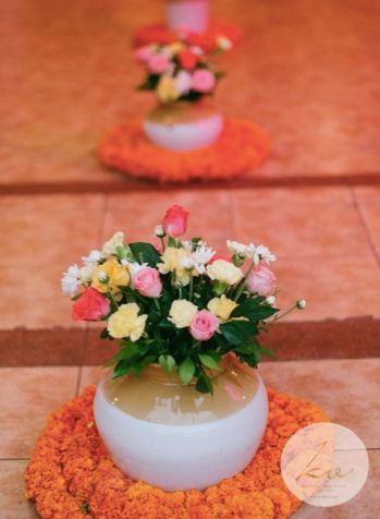 Photo of Pickle jars used as vases for the entrance decor