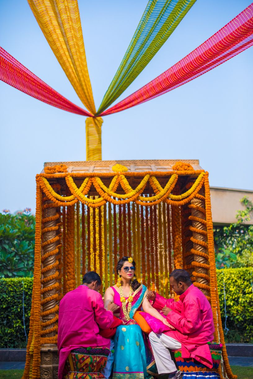 Photo of Mehendi swing decor with marigolds