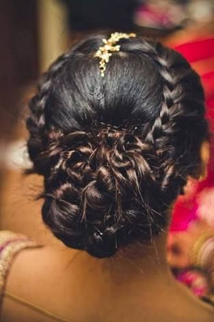Photo of Braided bun hairstyle for reception