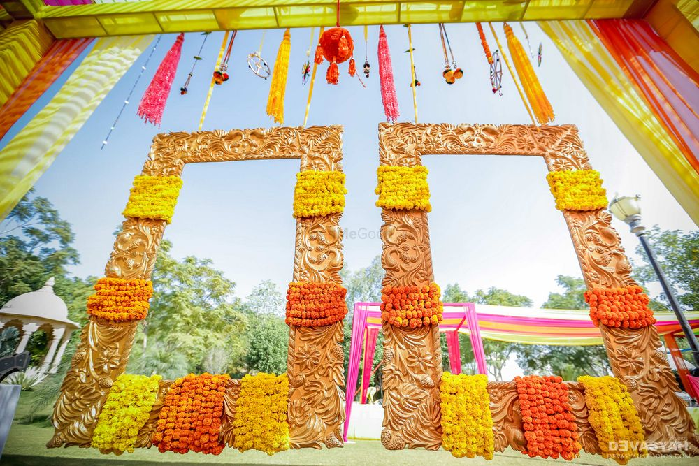 Photo of Hanging photobooth with frames decorated with marigold
