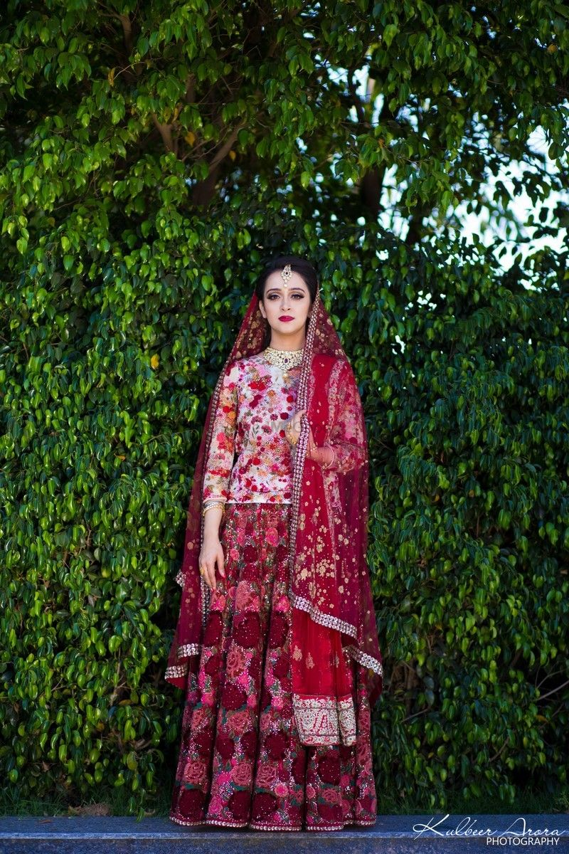 Photo of Lehenga with long blouse and floral embroidery