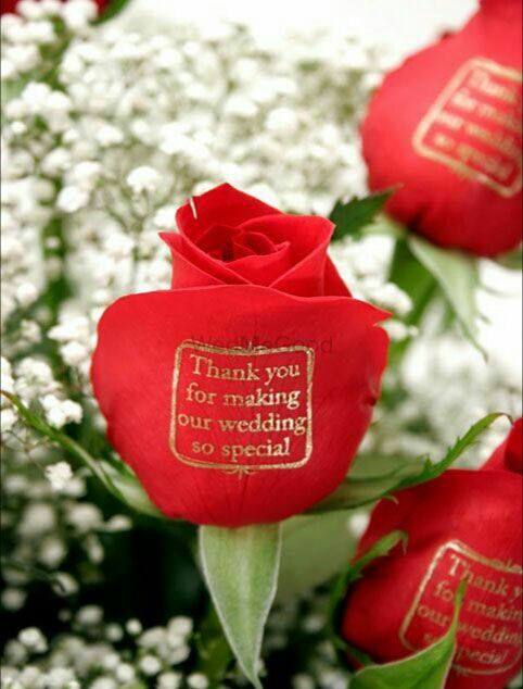 Photo of Simple thank you gift for guests with printed roses