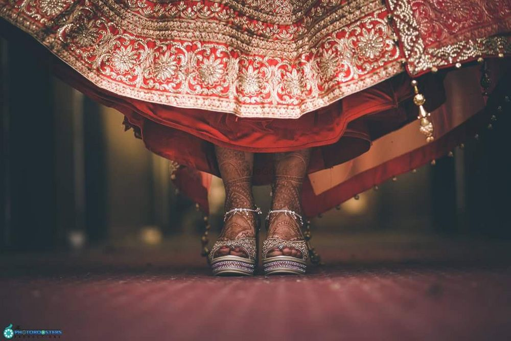 Photo of Silver bridal shoes with red lehenga