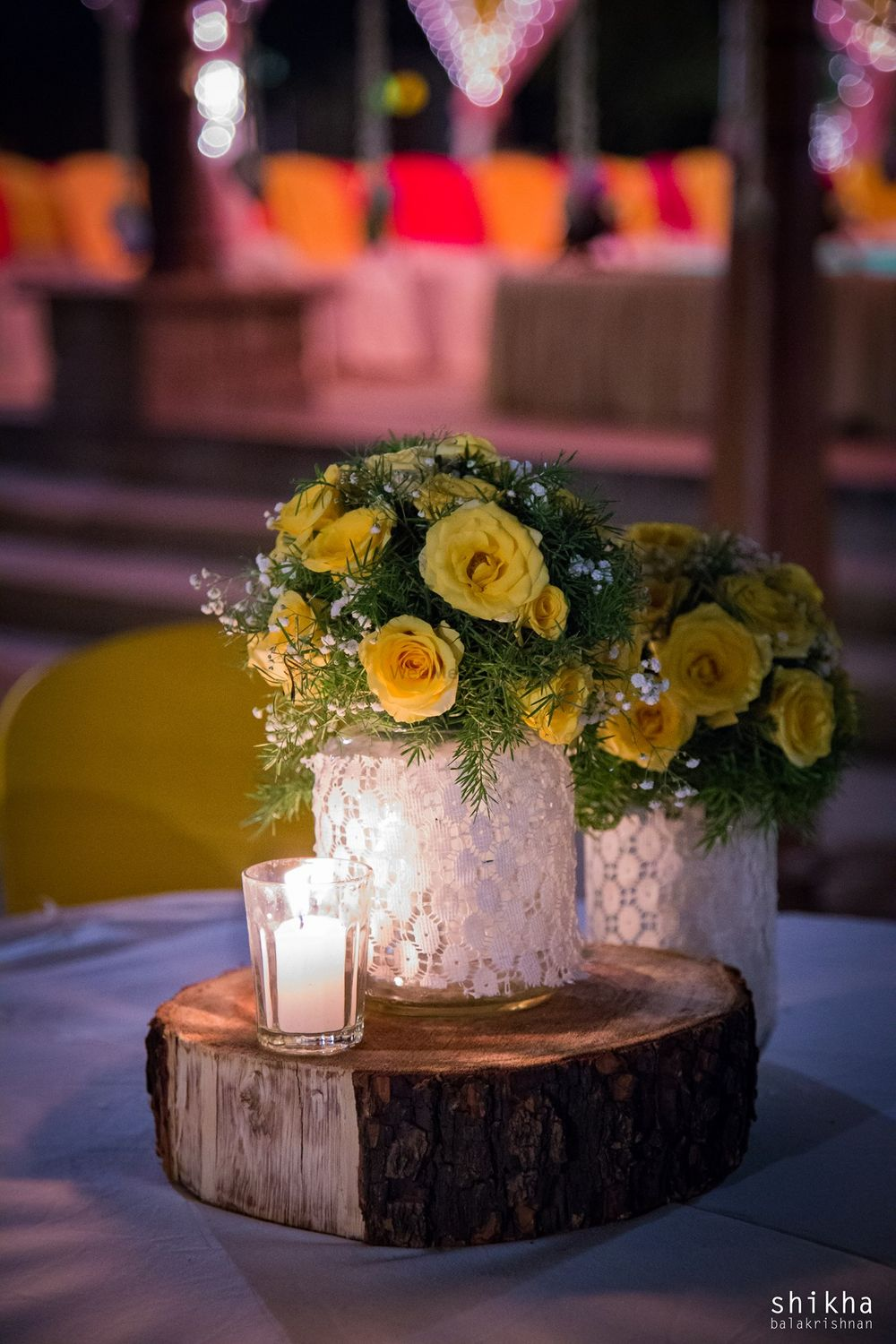 Photo of Mason jar with lace and flowers as centrepiece