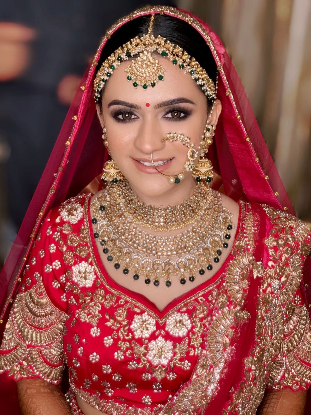 Photo of Bride in stunning gold jewellery.