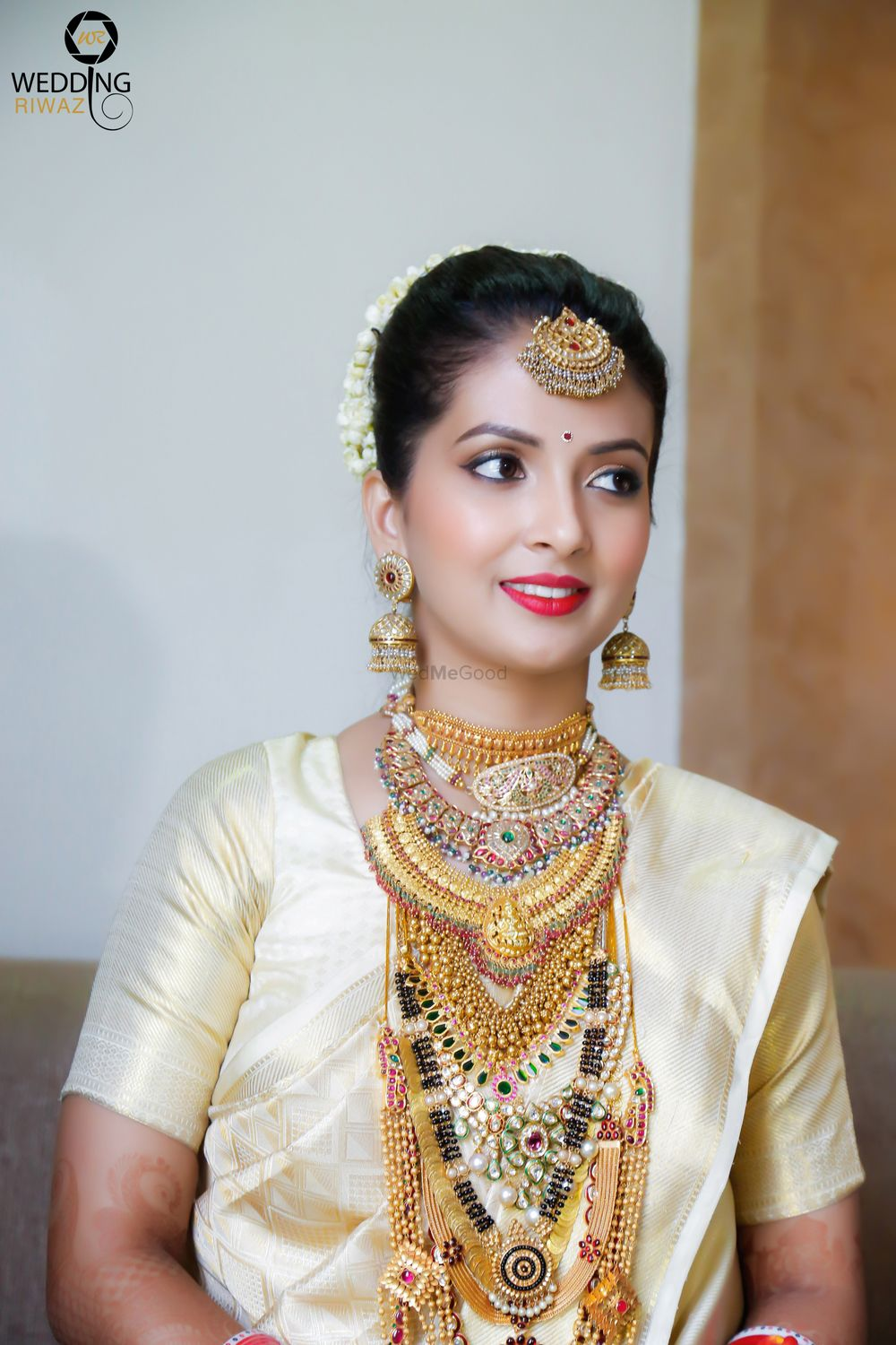 Photo of South Indian bride with multiple layered necklaces