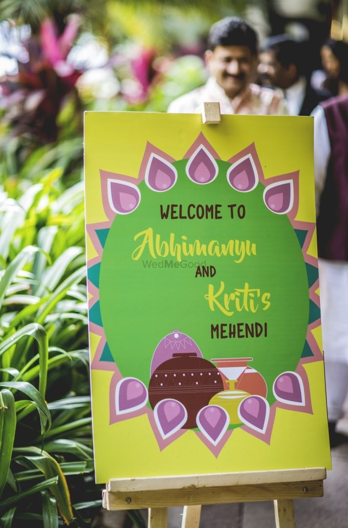 Photo of Mehendi entrance decor with printed board