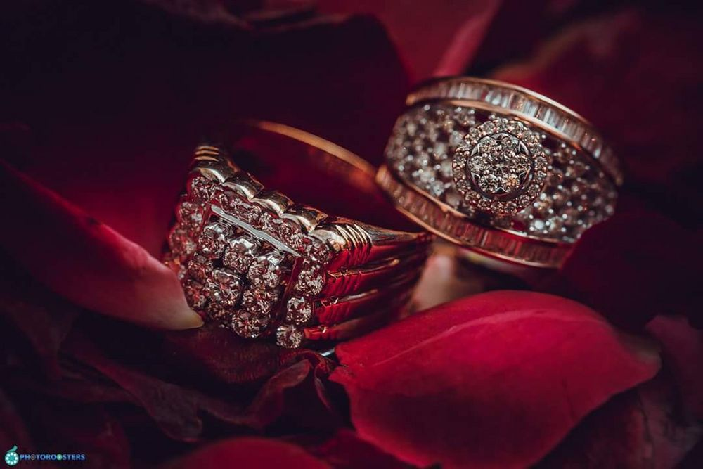 Photo of His and her grand diamond engagement rings