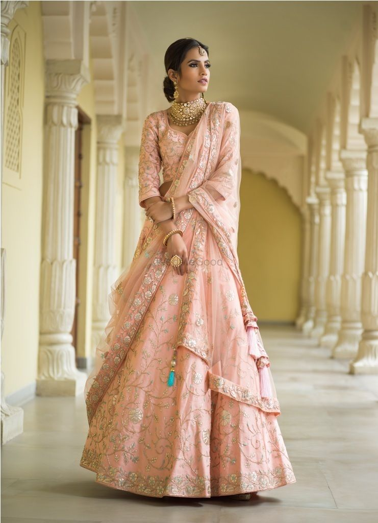Photo of Light pink and blue floral embroidery lehenga