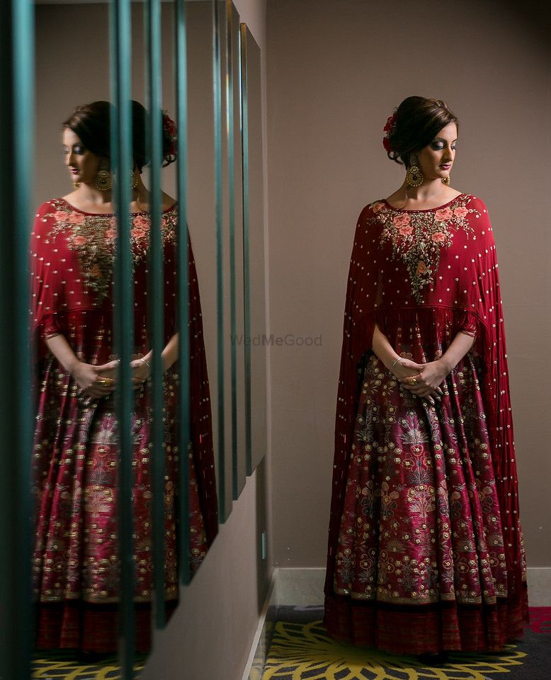 Photo of Sister of the bride maroon outfit with cape