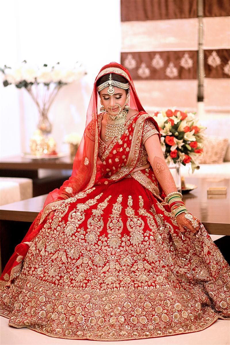 Photo of Red and gold flared out bridal lehenga portrait