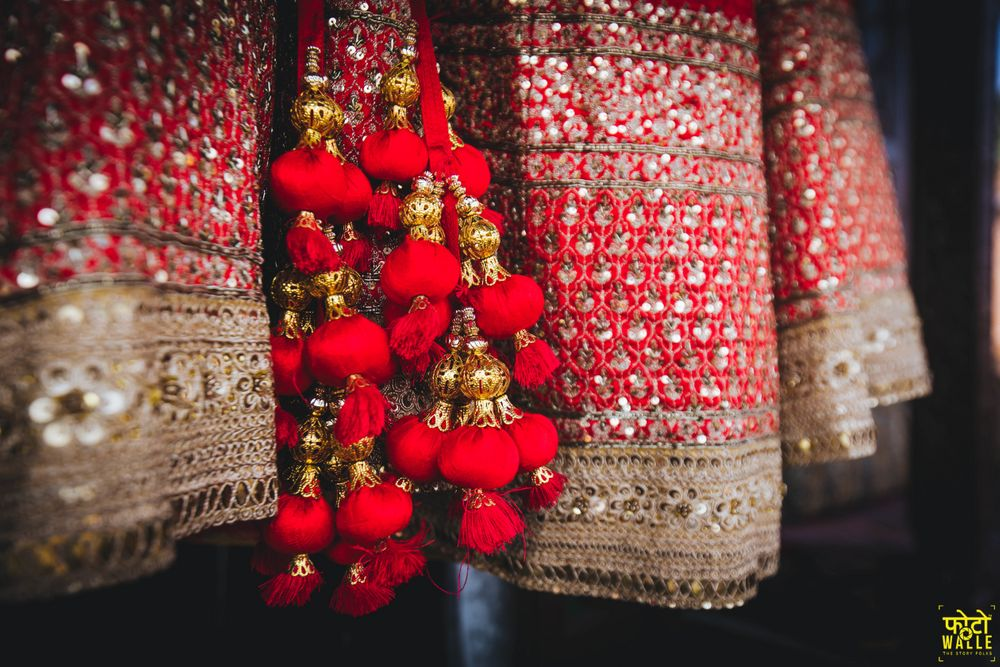 Photo of Heavy red bridal lehenga tassels