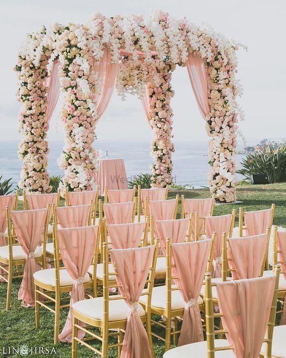 Photo of Pretty peach fairytale mandap and chair decor