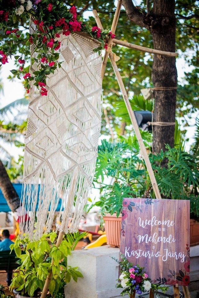 Photo of Mehendi entrance decor with crochet hanging