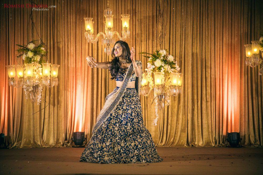 Photo of Bride dancing on sangeet shot