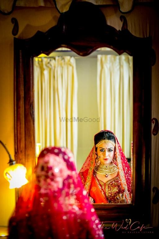 Photo of Bride getting ready looking in mirror shot