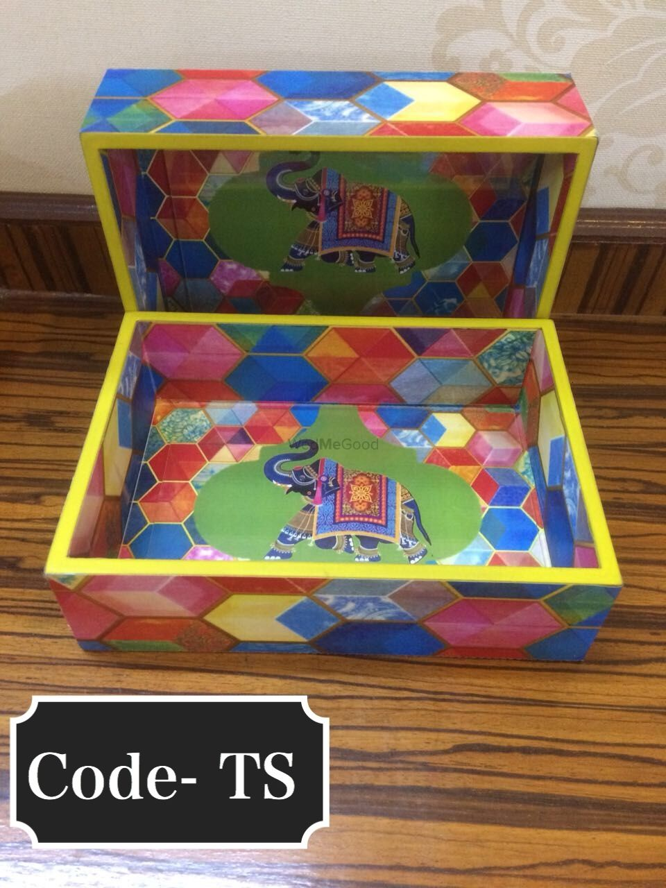 Photo of Wooden favour box for invite with elephant motif