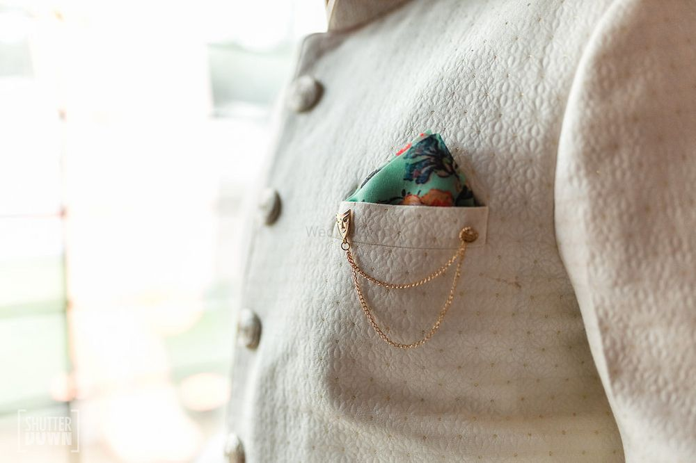 Photo of Groom accessories pocket square and brooch