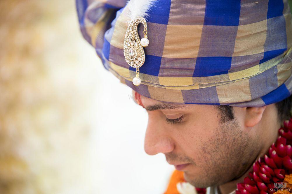 Photo of Unique checked safa for modern groom