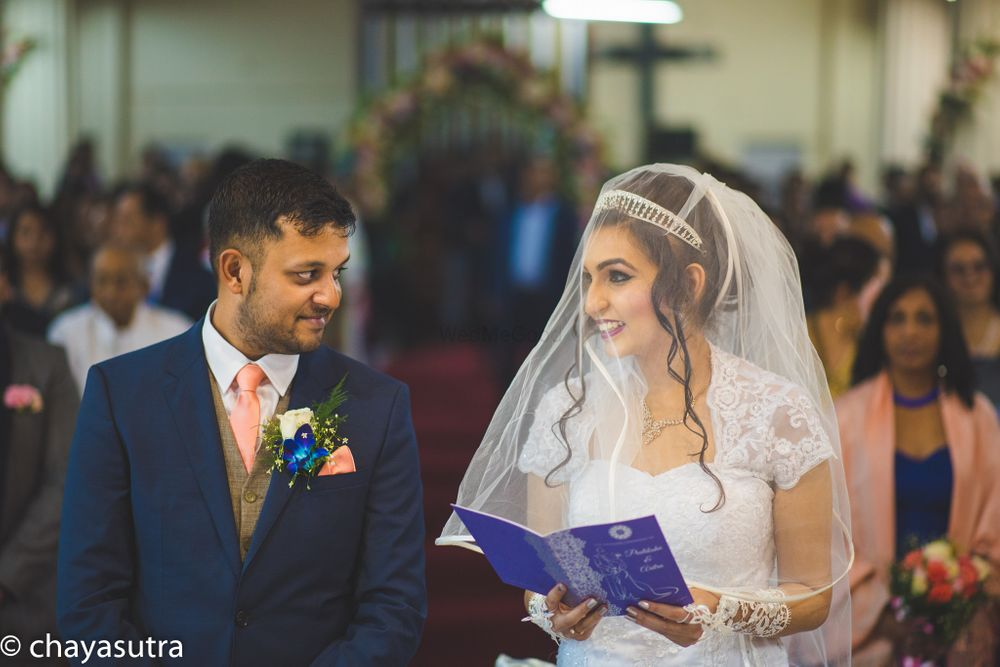 Photo of A Christian couple stand in the church for their wedding