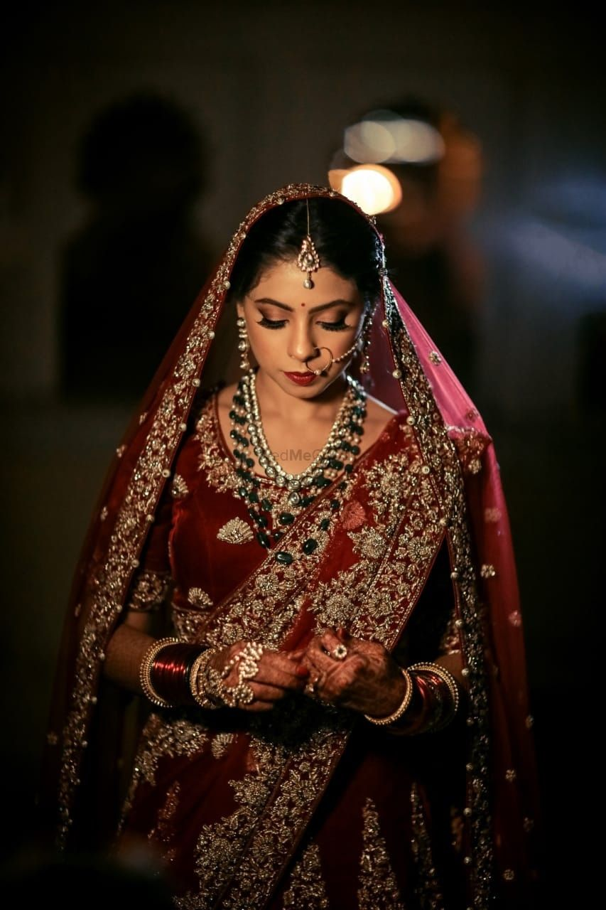 Photo of Maroon bridal lehenga with darker jewellery