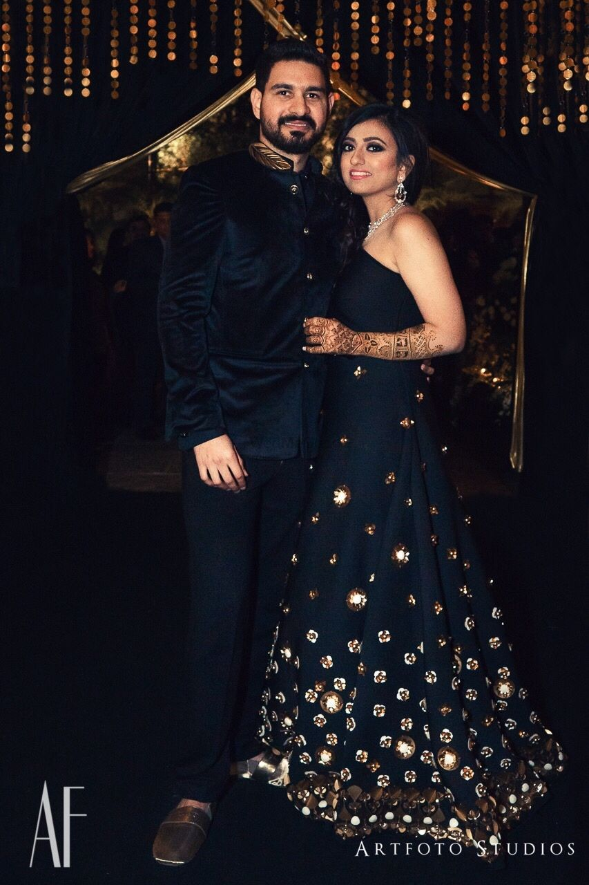 Photo of Black cocktail gown with gold work for sangeet