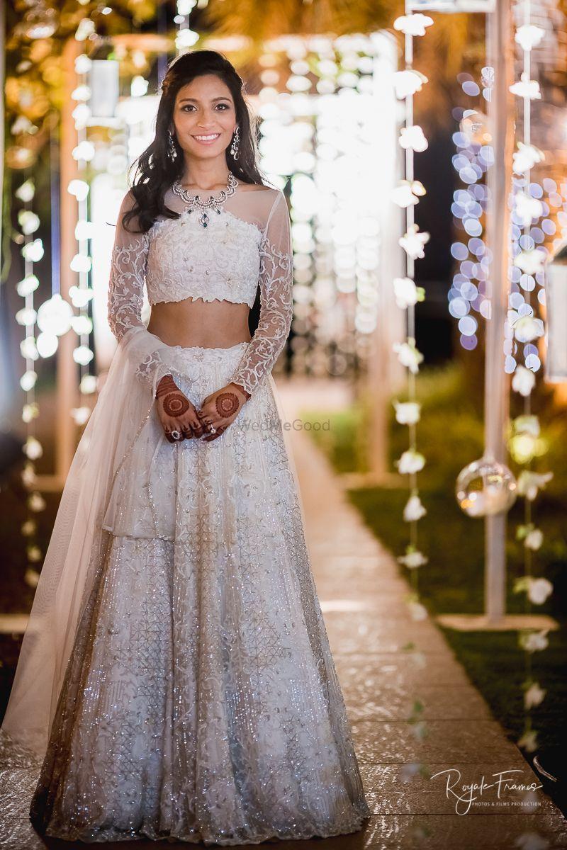 Photo of White engagement lehenga with sheer blouse