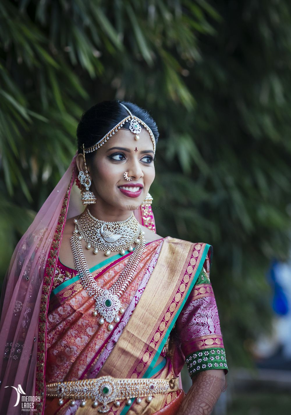 Photo of South Indian bridal jewellery with diamonds and emeralds