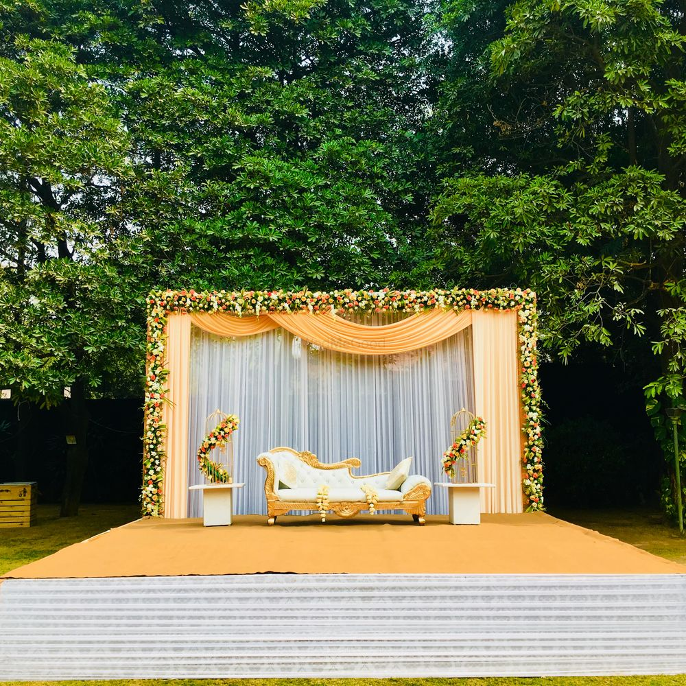 Photo of Lovely peach stage decor with florals